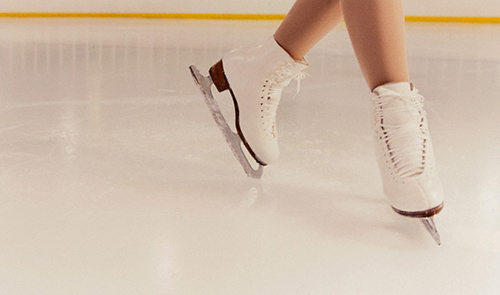 Figure Skater Skating Around Rink