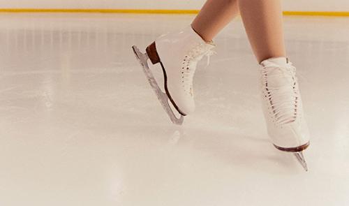 Figure Skater Skating Around Rink